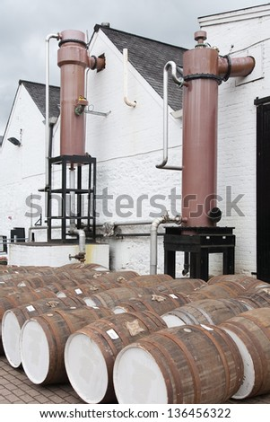 Whiskey barrels along Glenturret distillery in Perthshire, Scotland - stock photo