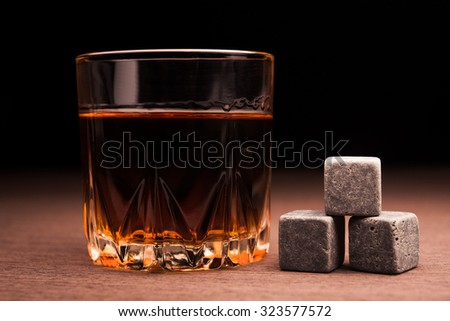 Whiskey beverage in glass. Alcohol background. - stock photo
