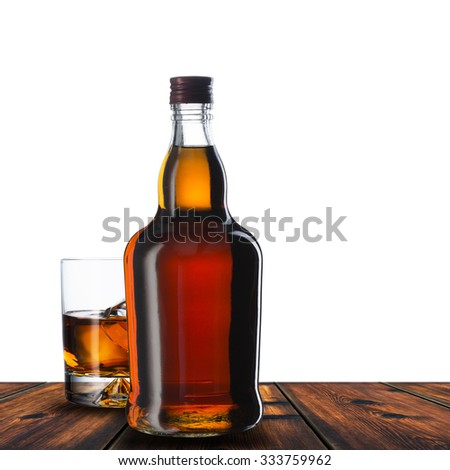 Whiskey Bottle And Glass On Wood Table - stock photo