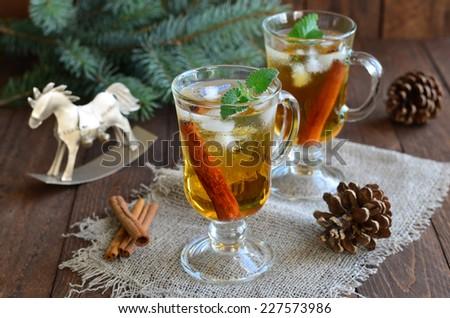 Whiskey cocktail on Christmas background horizontal - stock photo