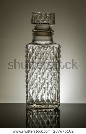 whiskey decanter with grey background  - stock photo