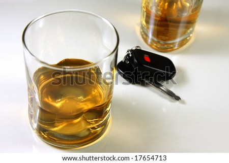 Whiskey drink with car keys, drunk driving and prevention. - stock photo
