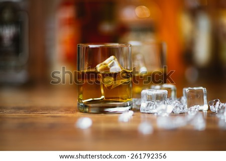 Whiskey drinks on  wood in bar - stock photo
