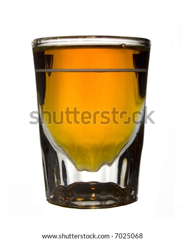 Whiskey in a crystal shot glass isolated on white. - stock photo