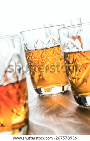 whiskey in crystal wine-glasses - stock photo
