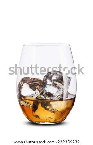 Whiskey in glass with ice cube. On the rock - stock photo