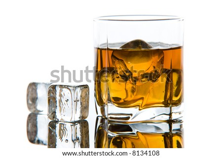 Whiskey in glass with ice cubes