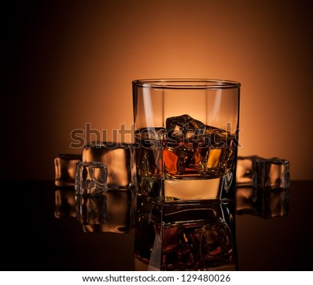 whiskey in glass with reflection - stock photo