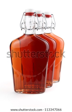 Whiskey in old-fashioned swing top bottles - stock photo