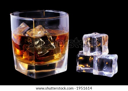 Whiskey in tumbler and ice cubes over black - stock photo