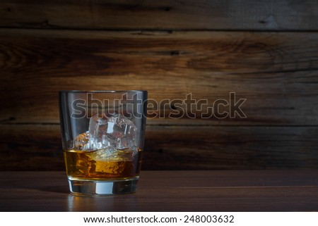 whiskey on a wooden background - stock photo