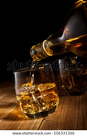 Whiskey on the rocks. - stock photo
