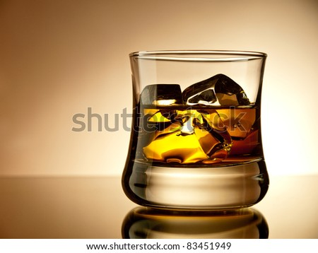 Whiskey on the rocks in an old fashion glass - stock photo