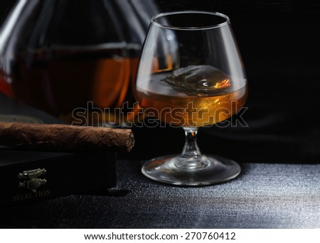 whiskey on the rocks, whiskey glass, whiskey bottle, cigar - stock photo