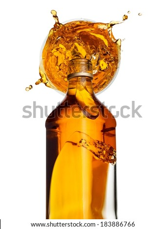 Whiskey pour and splash, top view - stock photo