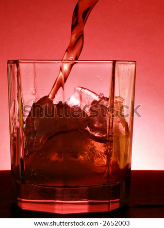Whiskey pour into the glass - stock photo