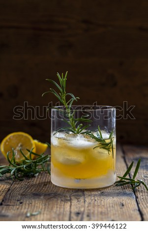 Whiskey sour cocktail with lemon juice, honey and rosemary - stock photo