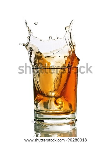 Whiskey splash in a glass, isolated, white background - stock photo