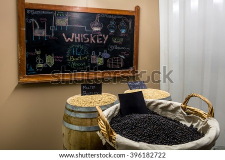 Whiskey whisky distillery copper still pots wooden casks process making alcohol    - stock photo