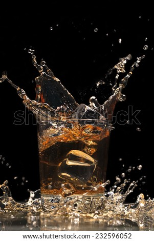 whiskey with ice cubes in a glass - stock photo
