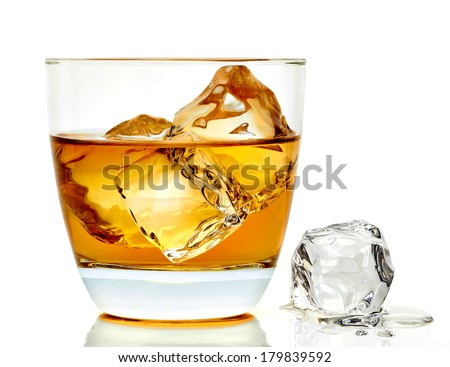Whiskey with ice cubes in rocks glass on white background - stock photo