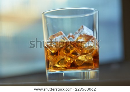 whiskey with ice on a table