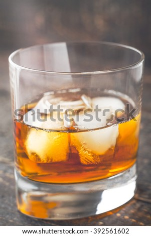 Whiskey with ice  on the wooden table