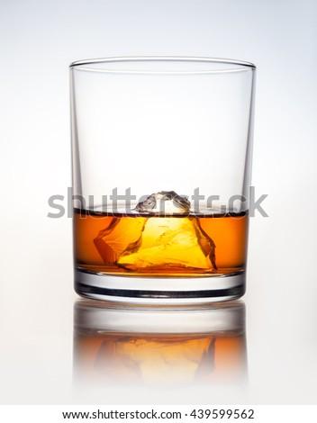 whiskey with ice on white background - stock photo