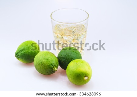 Whiskey with lime. Isolated on white background - stock photo