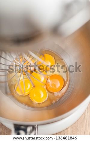 Whisking eggs - stock photo