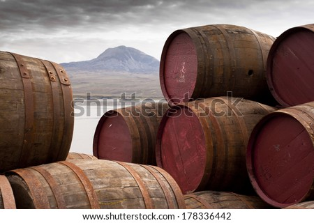 Whisky Barrels on Islay/View over to Jura/Whisky barrels stacked up - stock photo