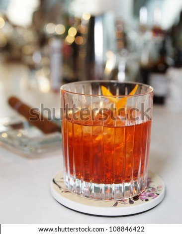 Whisky cocktail on bar counter - stock photo