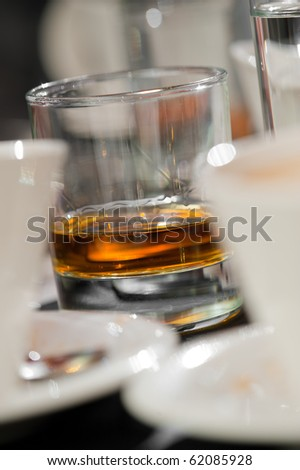 Whisky glass on  table - stock photo