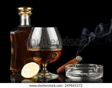 Whisky in glasses and smoking cigar in spot light - stock photo