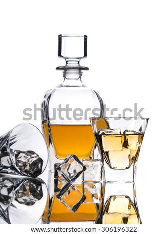 Whisky on the rocks with decanter and ice cubes - stock photo
