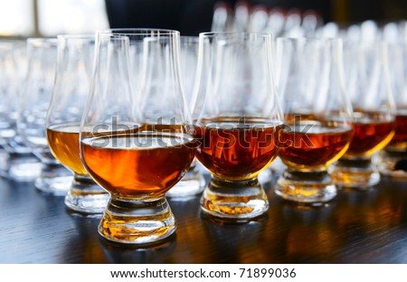 Whisky or cognac in snifters, soft focus, amber-blue toned - stock photo
