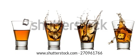 whisky splash in glass isolated on a white background - stock photo