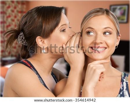 Whispering. - stock photo