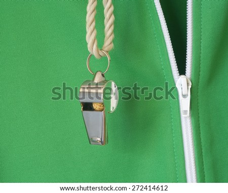 whistle of a soccer o. football referee w. sweat suit, close up, free copy space - stock photo