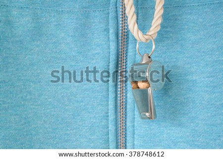 whistle of a soccer or football referee or trainer, free copy space - stock photo
