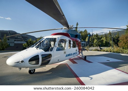 WHISTLER- JUNE 14, 2008: The BC Ambulance Service is a part of BC Emergency Health Services, established in 1900s. Ambulance Helicopter was photographed in Whistler Village. British Columbia, Canada. - stock photo