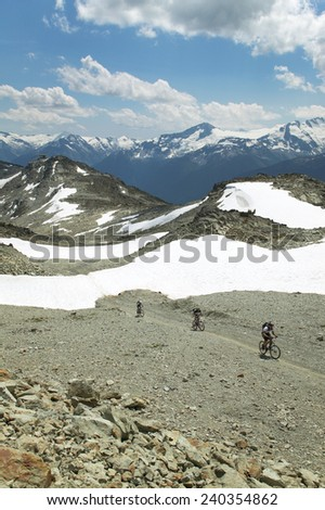 Whistler landscape with cyclist. British Columbia. Canada. Vertical - stock photo