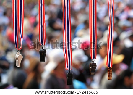 Whistles with Thailand  flag lanyard hanging for sale at Thai rally