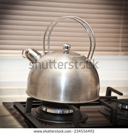 Whistling kettle on the stove - stock photo