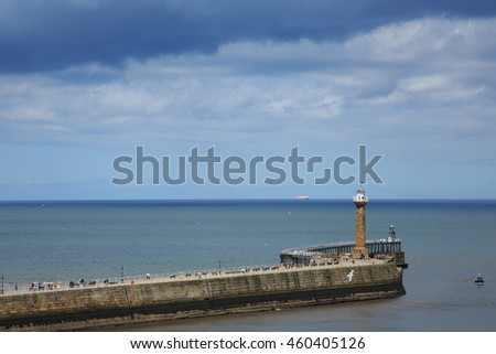 Whitby, England - 8 July 2016: The fishing port of Whitby lies on the coast of North Yorkshire in England and is a popular destination for tourists