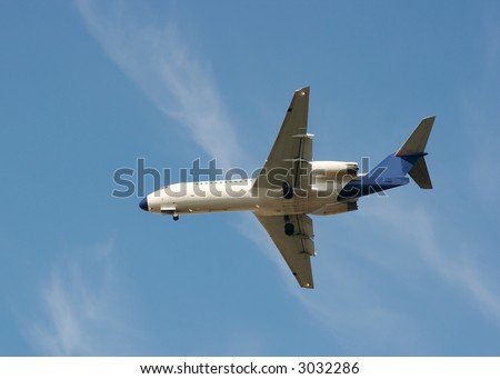 White airplane make landing under blue sky - stock photo
