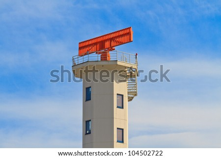 White Airport Tower with red radar on top - stock photo