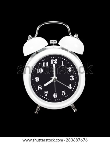 White alarm clock isolated on black with clipping path - stock photo