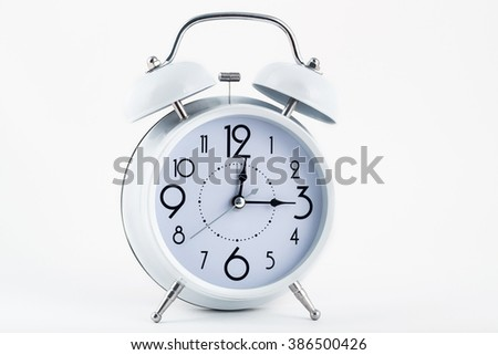 White alarm clock with numbers - stock photo