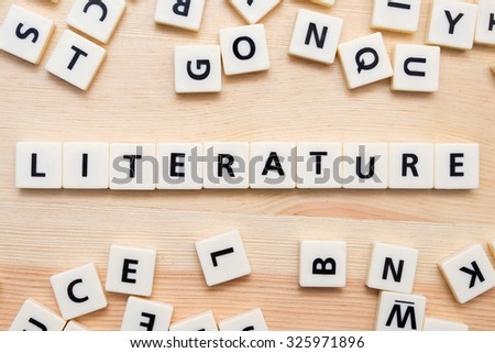 White alphabet blocks spelling the word Literature.